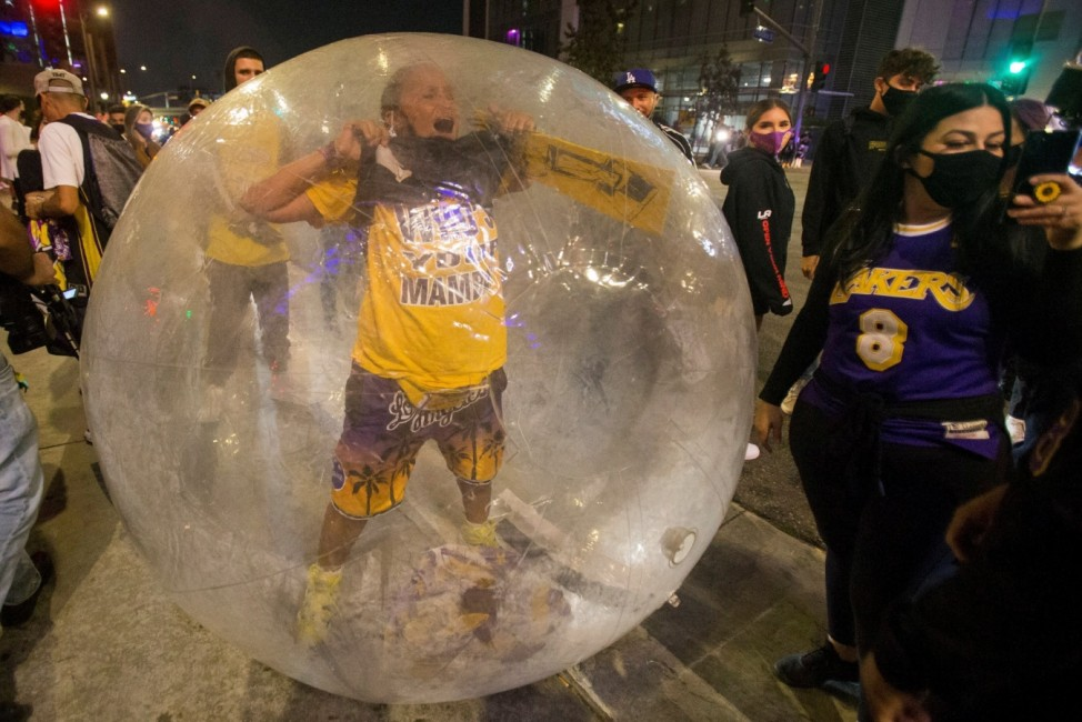 Los Angeles Lakers fans celebrate their team winning the 2020 NBA Championship against the Miami Heat