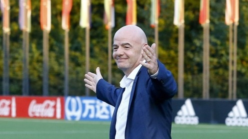 FIFA's President Infantino walks over a pitch in Zurich
