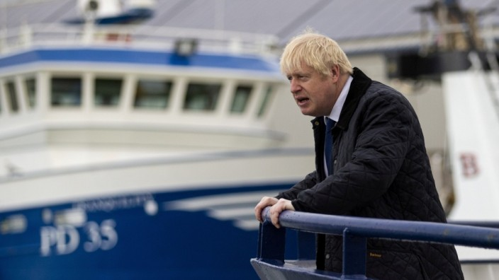 FILE PHOTO: Britain's Prime Minister Boris Johnson is seen aboard the Opportunus IV fishing trawler in Peterhead