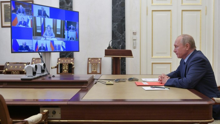 Russia's President Putin takes part in a video conference call with members of the Security Council in Moscow