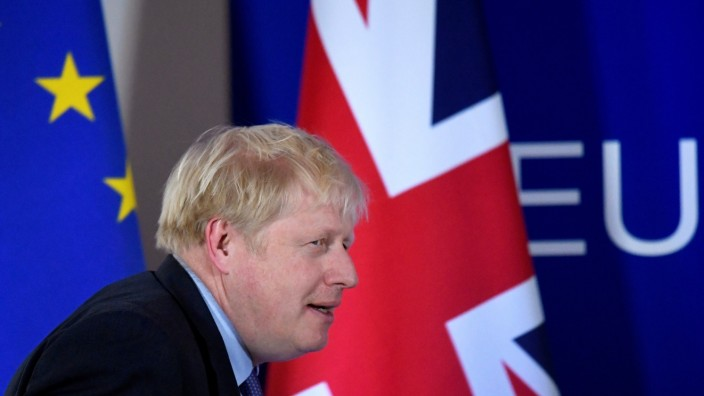 FILE PHOTO: Britain's Prime Minister Boris Johnson arrives to attend a news conference at the European Union leaders summit in Brussels