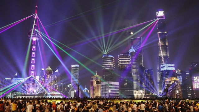 SHANGHAI, CHINA - OCTOBER 01: Buildings at the Lujiazui Financial Centre are illuminated during a light show to celebra