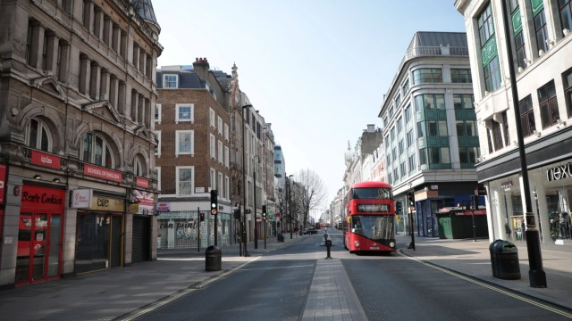 The streets of downtown London are near empty after Prime Minister Boris Johnson imposed a national lockdown from the r