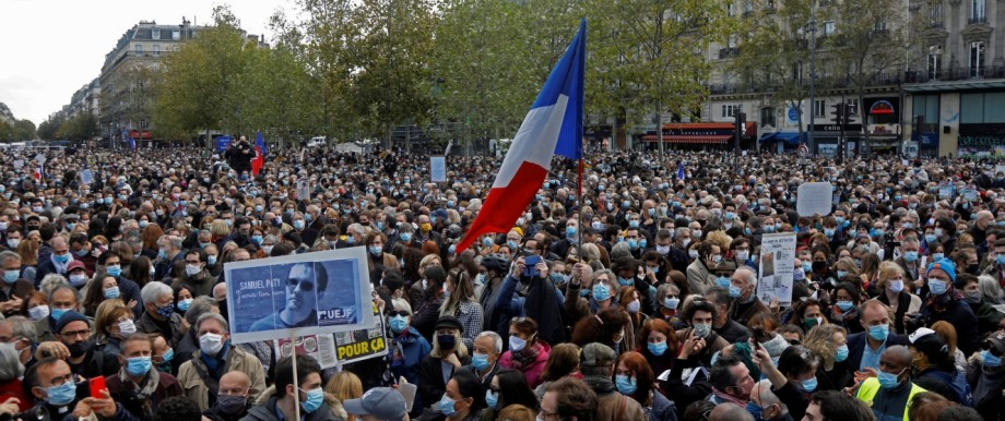 People pay tribute to beheaded teacher Samuel Paty in Paris