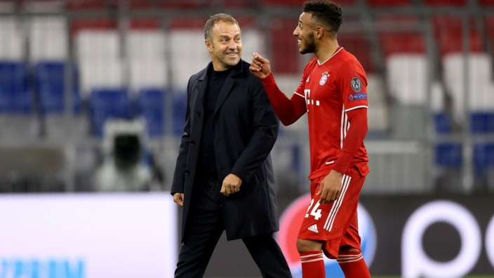 FC Bayern München: Hansi Flick und Corentin Tolisso nach dem Spiel gegen Atlético Madrid