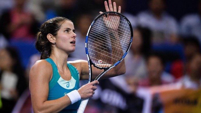 Julia Goerges of Germany celebrates after defeating Kristina Mladenovic of France in the Group A match of the women s s