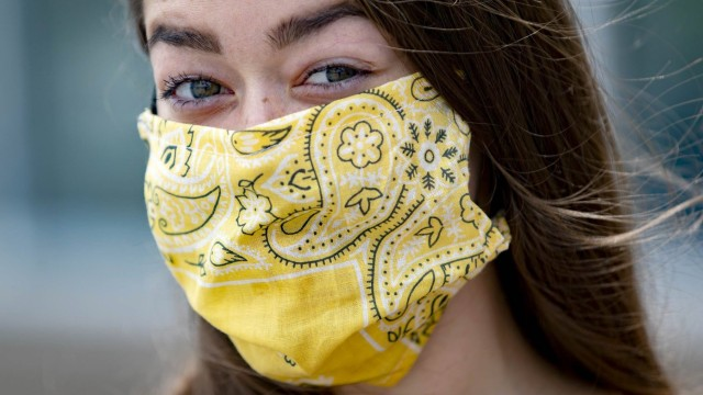 April 13, 2020, Royal Palm Beach, Florida, USA: Sabrina Vargas, West Palm Beach, fashioned a mask out of a yellow bandan