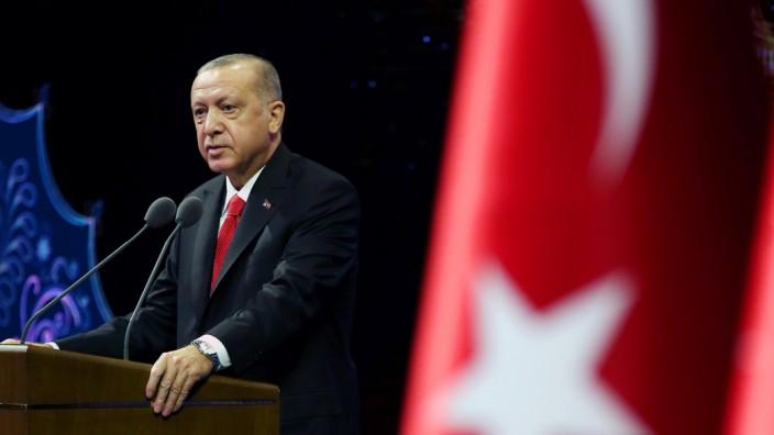 Turkish President Erdogan makes a speech during a meeting in Ankara