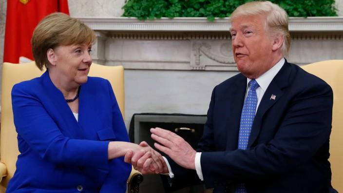 U.S. President Trump welcomes German Chancellor Merkel at the White House in Washington
