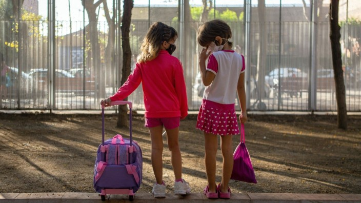 Two children arrive for the first day of school in the Escola Catalonia school in Barcelona, Spain, 14 September 2020. A