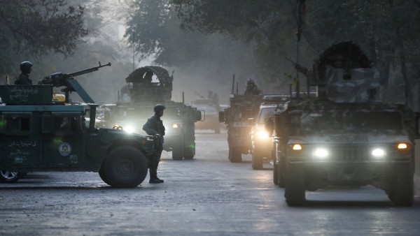 Afghan security forces leave the site of an incident after an attack at the university of in Kabul
