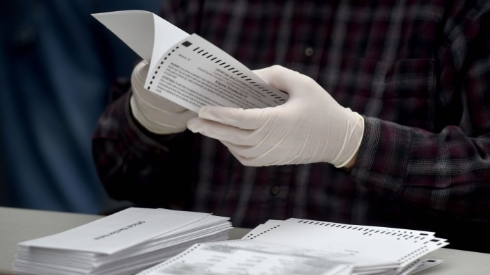 November 3, 2020, Wilkes-Barre, Pennsylvania, United States: A county employee opens a mail in ballots at the Luzerne Co