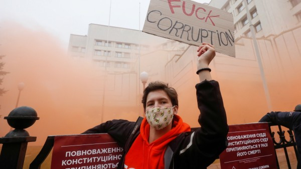 A protester takes part in a rally outside the Constitutional Court building in Kyiv