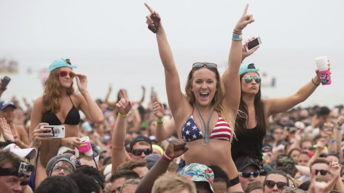 Fans sing along with Luke Bryan in concert during spring break festivities in Panama City Beach Florida