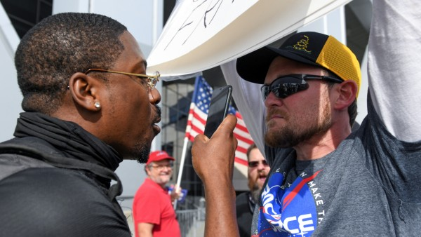 A man argues with a supporter of U.S. president Donald Trump outside the State Farm Arena in Atlanta