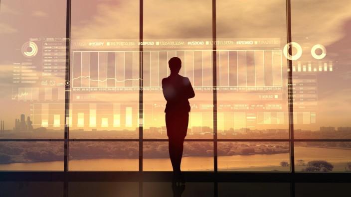 Silhouette of business woman and stock exchange infographics PUBLICATIONxINxGERxSUIxAUTxONLY Copyri