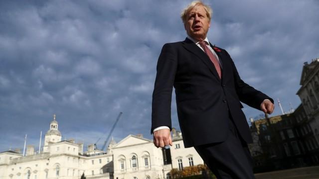 Prime Minister Boris Johnson walks across Horse Guards Parade in London