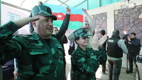AZERBAIJAN - NOVEMBER 8, 2020: Azerbaijani border guards react as Azerbaijan s president Aliyev announces in a televised