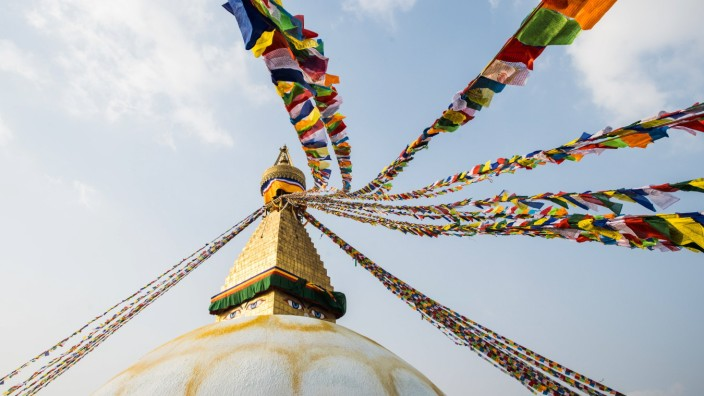 The Buddha Stupa strung with Prayer flags in Kathmandu Nepal Kathmandu, Central Development Region, Nepal PUBLICATIONxIN