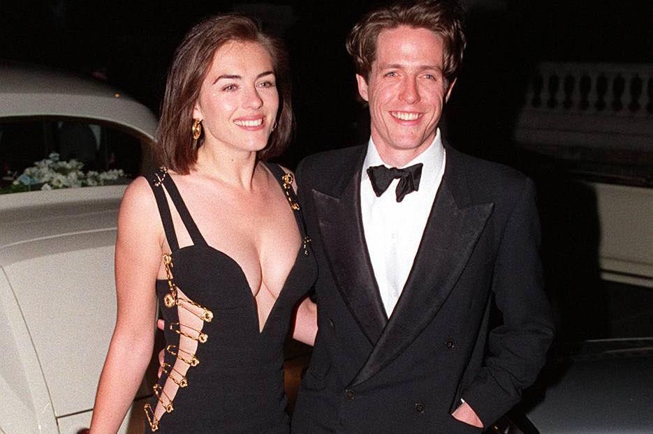 HUGH GRANT, British Actor with his girlfriend ELIZABETH HURLEY British...