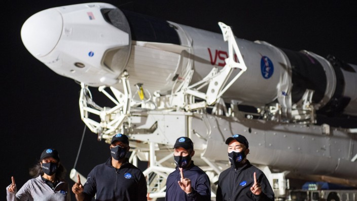 NASA astronauts Shannon Walker, left, Victor Glover, second from left, Mike Hopkins, second from right, and Japan Aeros