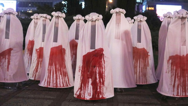 Participants stage a performance during a protest against the ruling imposing a near-total ban on abortion in Warsaw