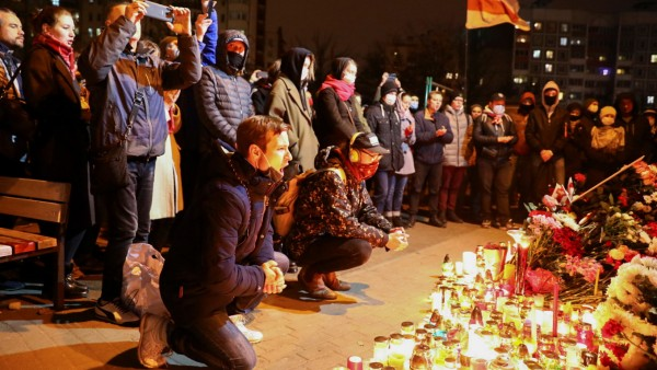 People gather to mourn the death of anti-government protester Roman Bondarenko in Minsk