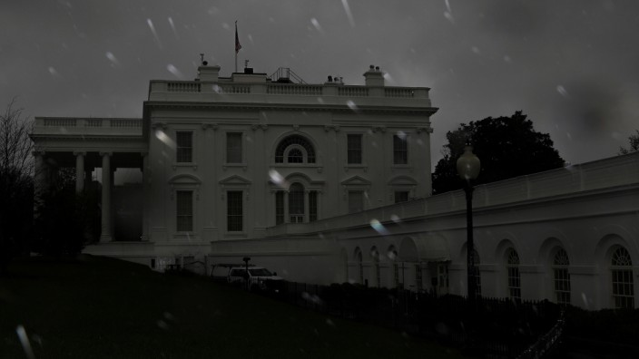Rain falls over the White House during a storm in Washington