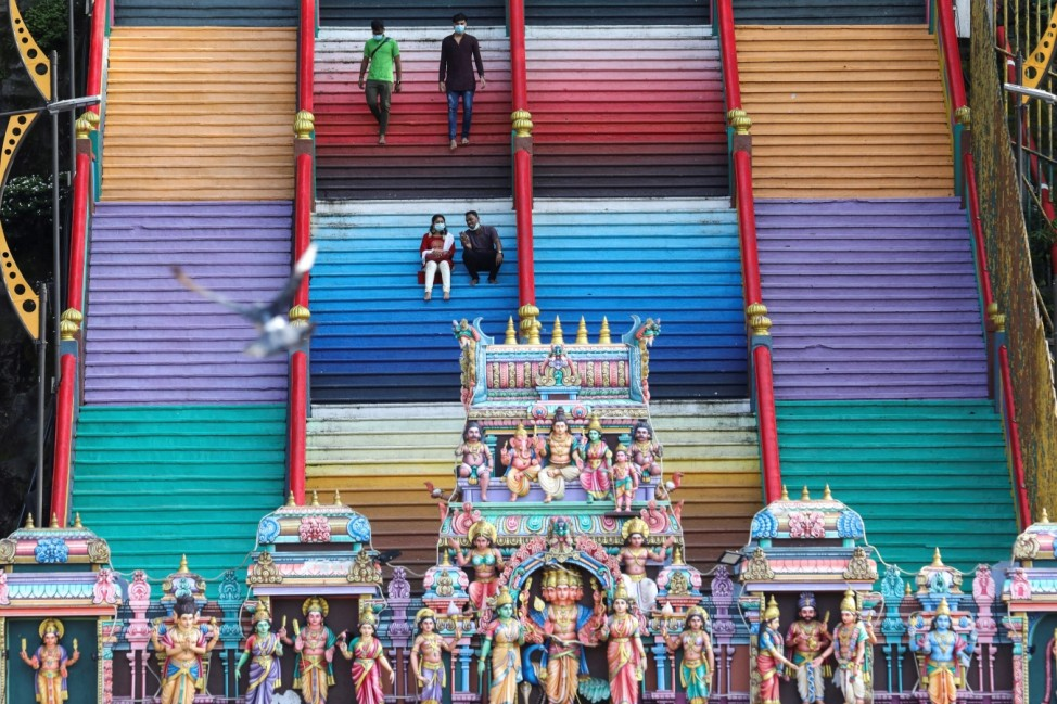 Devotees rest on stairs at a temple, during the Hindu festival of Diwali, amid the coronavirus disease (COVID-19) outbreak in Kuala Lumpur