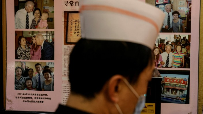 Pictures of the 2011 visit of then-Vice President Joe Biden to the Yaoji Chaogan traditional Beijing cuisine restaurant are seen at its sister restaurant  in Beijing