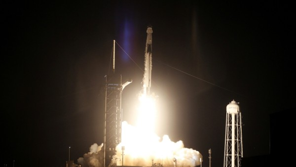 A SpaceX Falcon 9 rocket, topped with the Crew Dragon capsule, is launched carrying four astronauts on the first operational NASA commercial crew mission at Kennedy Space Center in Cape Canaveral, Florida