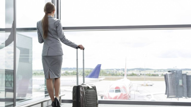 Businesswoman at the airport looking out of window model released Symbolfoto property released PUBLI