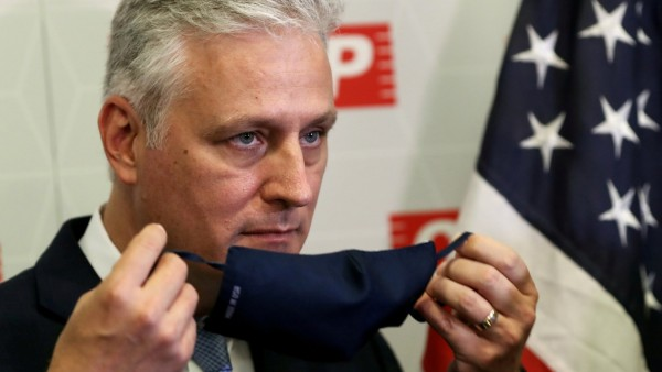 FILE PHOTO: U.S. national security adviser Robert O'Brien takes off his a face mask during a meeting at Sao Paulo's Industries Federation President in Sao Paulo