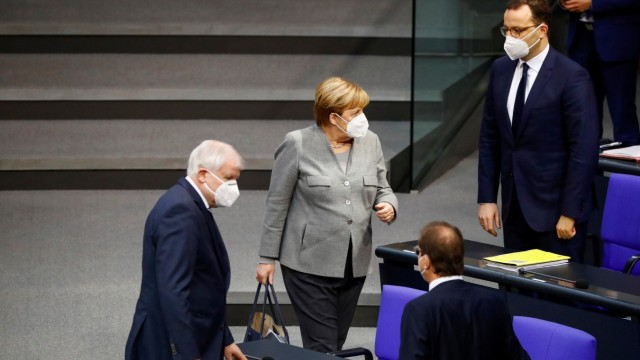 German Chancellor Merkel arrives to attend a session of the German lower house of parliament, in Berlin