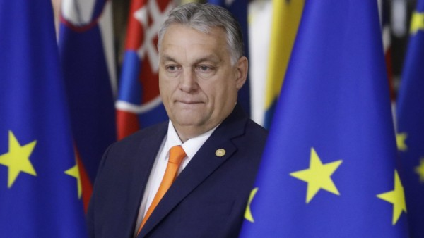 Hungary Prime Minister Viktor Orban arrives for a family photo during the first day of the EU summit meeting, Thursday