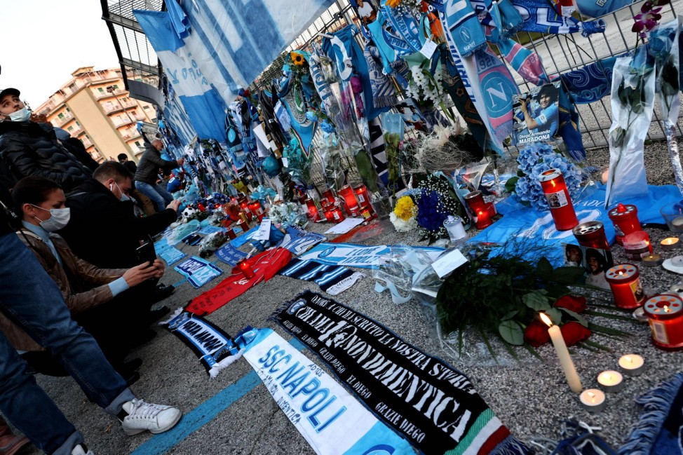 People gather to mourn the death of Diego Armando outside the stadium prior to the UEFA Europa League football match be