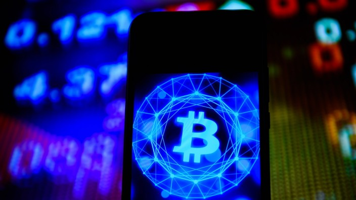 February 17, 2020, Poland: In this photo illustration a Bitcoin logo seen displayed on a smartphone. Poland PUBLICATION