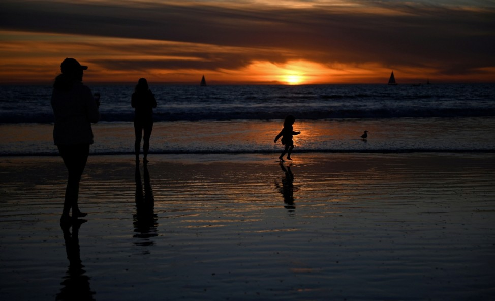 People visit the beach a day before renewed restrictions due to a surge of coronavirus disease (COVID-19) cases in Los Angeles