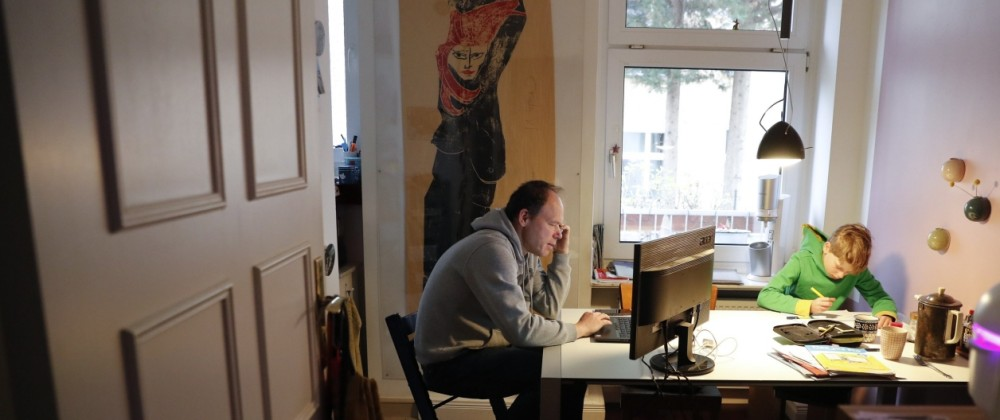 Holger Frohnmeyer studies with his son Rasmus at home during the spread of coronavirus disease (COVID-19) in Berlin