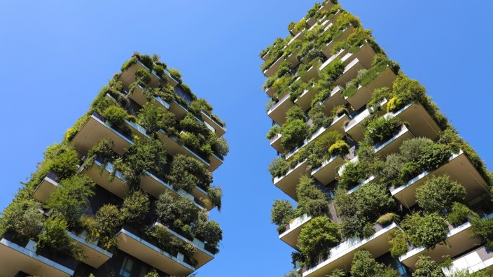 MILAN, ITALY - JULY 30, 2018: Modern and ecologic skyscrapers with many trees on every balcony. Bosco Verticale, Milan,