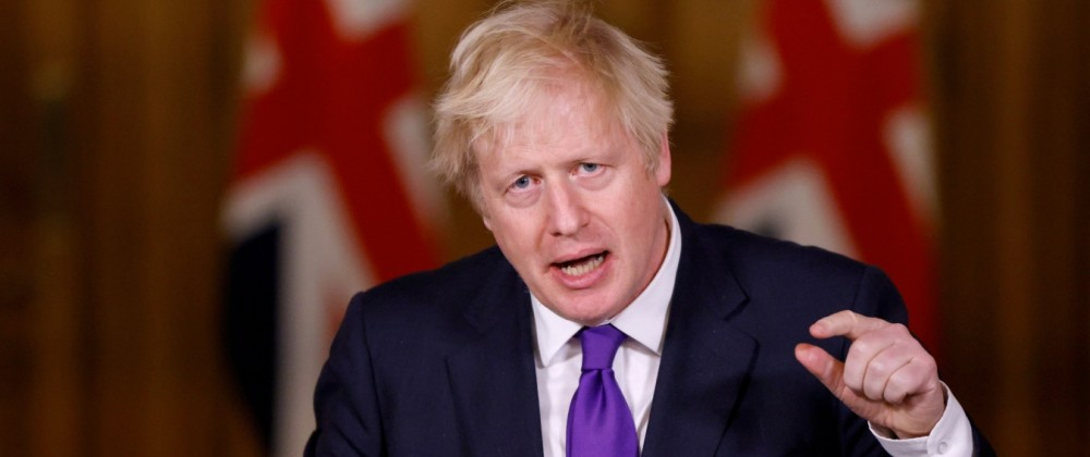 FILE PHOTO: Britain's PM Johnson attends a news conference in London