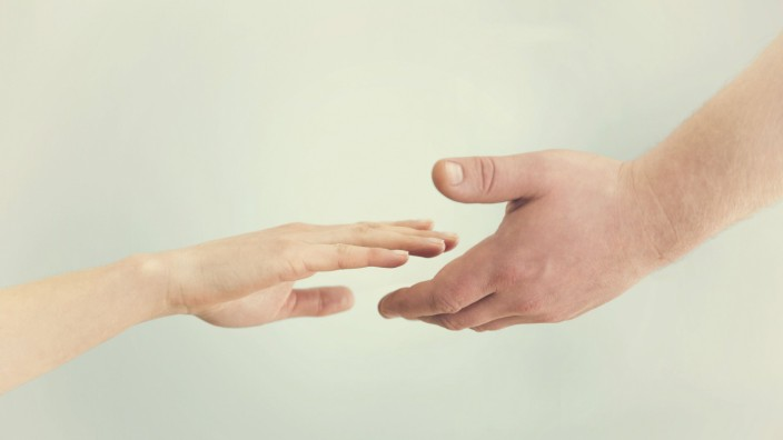 Support concept Two hands reaching toward each other Empathy compassion help kindness PUBLICAT