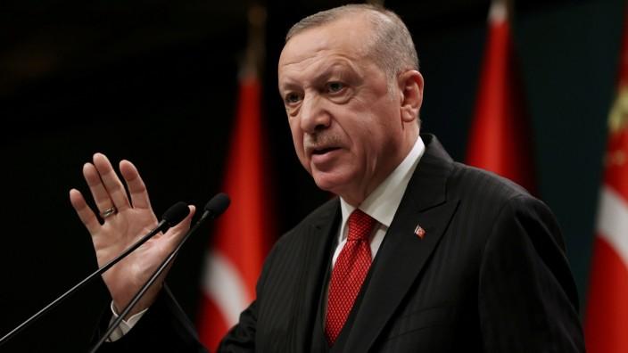 FILE PHOTO: Turkish President Erdogan talks during a news conference in Ankara