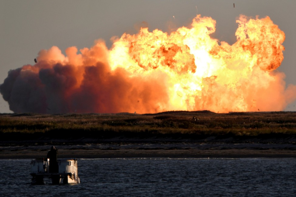 SpaceX's first super heavy-lift Starship SN8 rocket explodes during a return-landing attempt after it launched from their facility on a test flight in Boca Chica, Texas