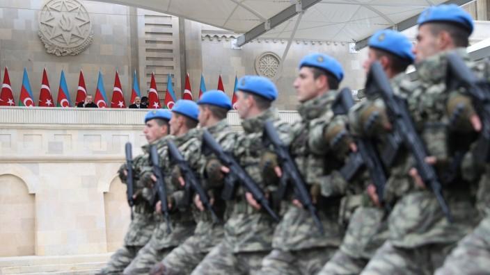 Presidents Erdogan of Turkey and Aliyev of Azerbaijan attend a military parade in Baku