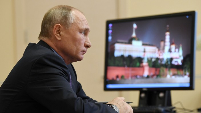 Russia's President Putin chairs a meeting with government members outside Moscow