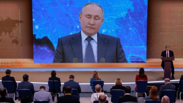 Journalists attend Russian President Vladimir Putin's annual end-of-year news conference in Moscow