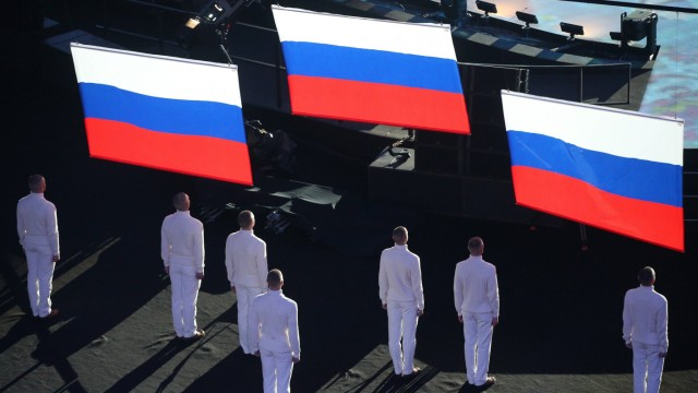 ITAR TASS SOCHI RUSSIA FEBRUARY 23 2014 Three Russian national flags raised during the medal ce; Russland