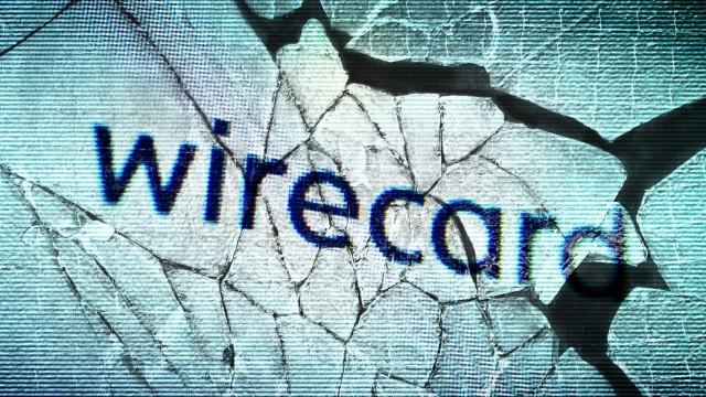 FOTOMONTAGE, Webseite des insolventen Zahlungsdienstleisters Wirecard auf zerbrochenem Glas, Wirecard-Finanzskandal ***