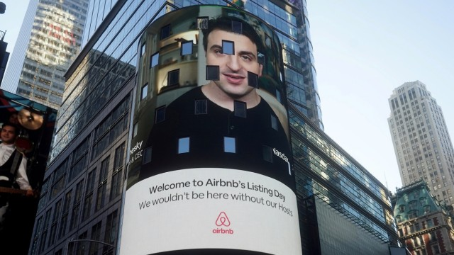 FILE PHOTO: The Nasdaq market site displays an Airbnb sign featuring CEO Brian Chesky on their billboard on the day of their IPO in Times Square